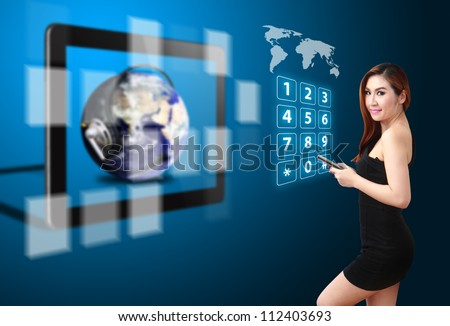 Lady and telecommunication world from touch pad : Elements of this image furnished by NASA - stock photo