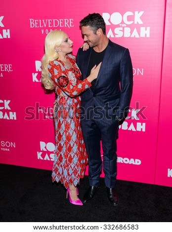 "Lady Gaga and Taylor Kinney arrive at the red carpet premiere of ""Rock The Kasbah"" in New York, NY on October 19th 2015 - stock photo"
