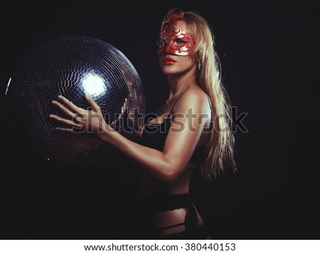 lady in mask with disco ball - stock photo