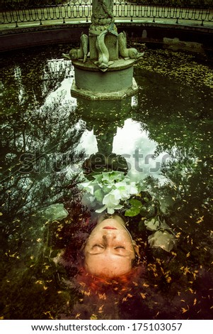 Lady in water fountain.Portrait of the elegant woman in medieval era dress. - stock photo