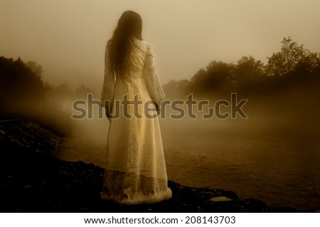 Lady in White Dress - Horror scene of the Woman Ghost in White Dress - stock photo