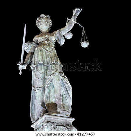 Lady Justice by night in Frankfurt. Germany. Isolated on black. - stock photo