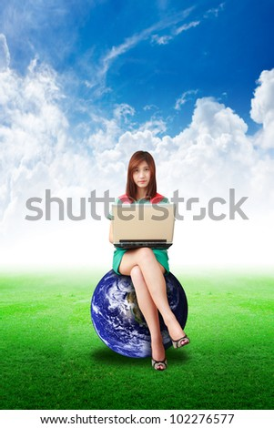 Lady on globe hold notebook computer and look a me : Elements of this image furnished by NASA - stock photo