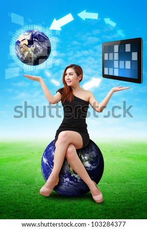 Lady on globe hold the world and touch pad : Elements of this image furnished by NASA - stock photo
