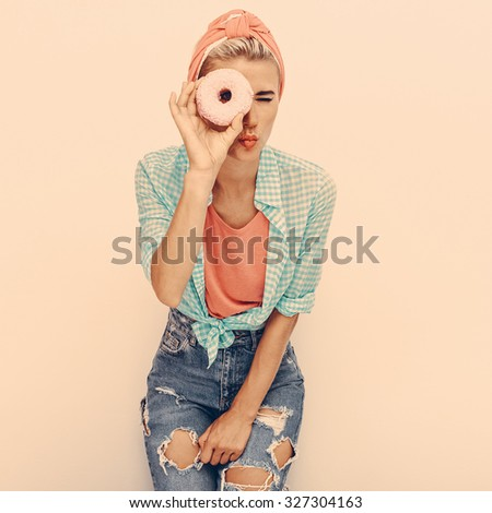 Lady retro Pin-up style with a Donut - stock photo