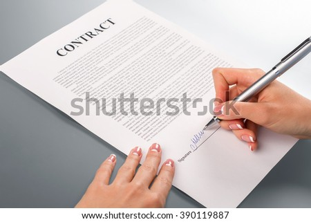Lady's hand signing promotion contract. Female hand signs promotion contract. We will help you. Companies should help each other. - stock photo