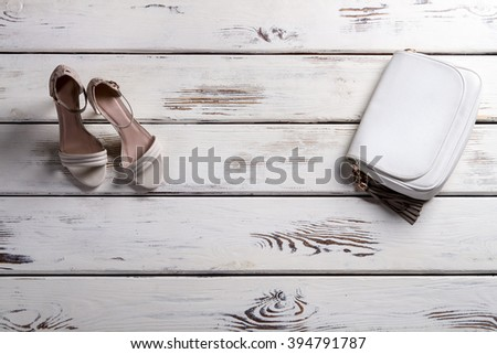 Lady's shoes and small purse. Showcase with footwear and purse. Leather purse and heel shoes. Elegant footwear and leather accessory. - stock photo