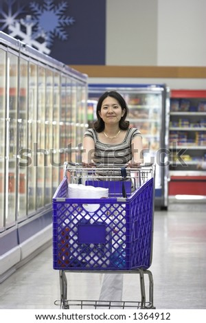 lady shopping in supermarket - stock photo