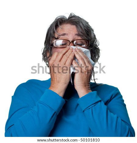 Lady sneezes, feeling unwell due to the flu - stock photo