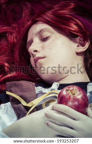 Lady, Teen with a red apple lying, tale scene - stock photo