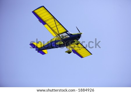 Lady visable in the cocpit of a light aircraft. - stock photo