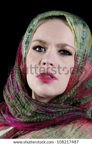 Lady with green and red silk scarf around her head - stock photo