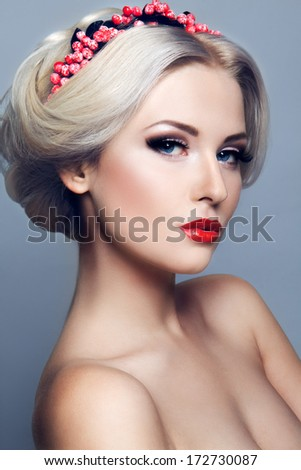 Lady with wreath of red berries - stock photo
