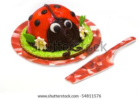 Ladybird cake isolated against white background - stock photo