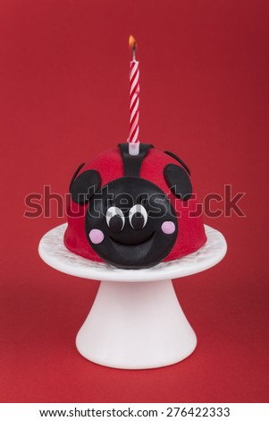 ladybird shaped birthday cake - stock photo