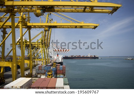 Laem Chabang - SEPTEMBER 12 : Large container ship bearthing for loading cargo at Laem Chabang harbour in Thailand, on September 12, 2013 - stock photo