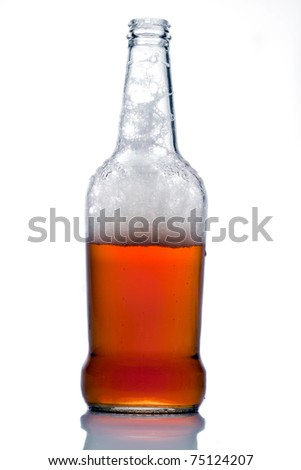 Lager beer in a open  buttle with froth - stock photo