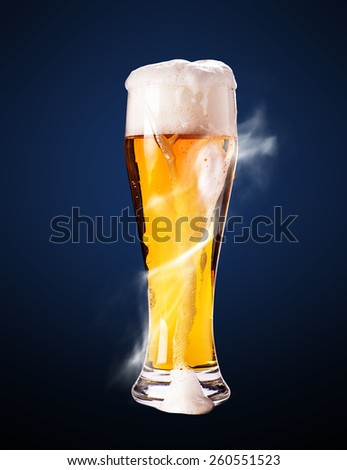 lager beer in goblet on a blue background - stock photo