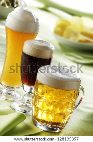 lager, dark and wheat beer glasses - stock photo