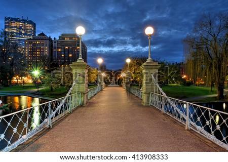Lagoon bridge at night in Boston Public Garden - stock photo