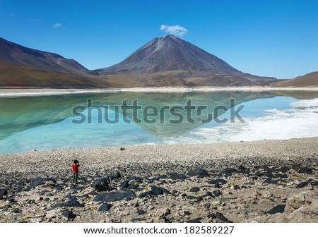 Laguna Verde is a salt lake at the foot of the volcanos Licancabur and Juriques - Eduardo Avaroa Andean Fauna National Reserve, Bolivia - stock photo