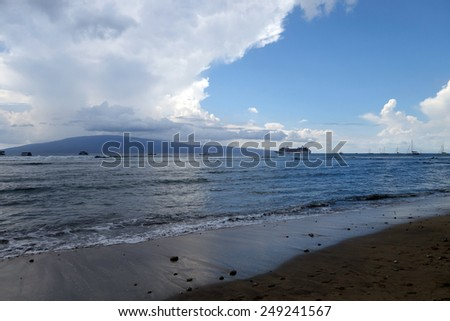 LAHAINA, HI - SEPTEMBER 30: Beach with Princess Cruise Ship docked along with other boats off coast of Maui with Lanai in the distance a passengers take small boat to shore on September 30, 2014. - stock photo