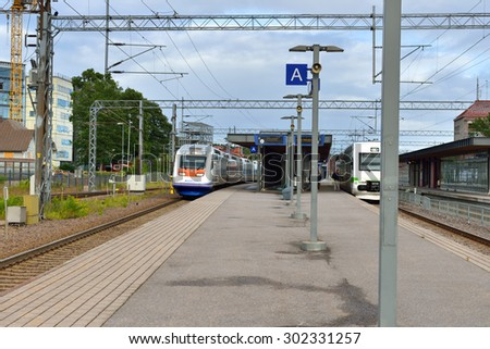 LAHTI, FINLAND - JULY 19,2015:Allegro train has maximum operating speed of 220 kph. Trains are owned by Karelian Trains, which is joint venture between VR Group (Finnish Railways) and Russian Railways - stock photo