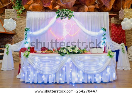 laid wedding banquet table with illumination at restaurant - stock photo