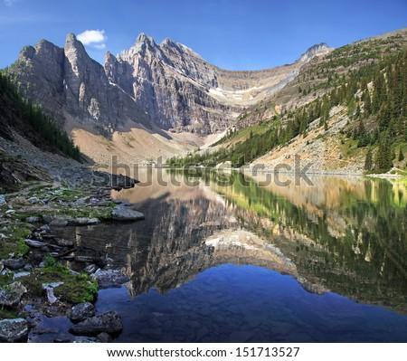 Lake Agnes, Lake Louise, Banff National Park, Alberta, Canada  Mount Whyte reflecting into Lake Agnes. - stock photo