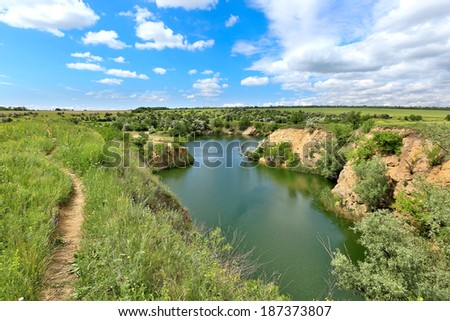 Lake among steppe in nice summer day - stock photo