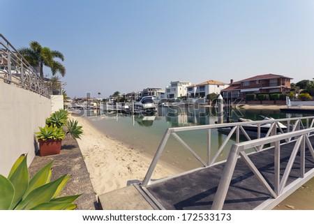 lake and pier behind modern waterfront australian mansion - stock photo