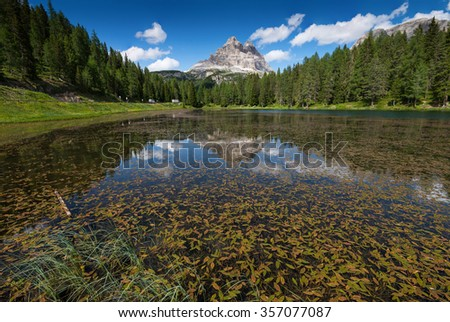 Lake Antorno in Dolomites with reflection - stock photo