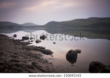 lake at dawn - derwent water in the lake district - stock photo
