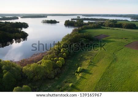 Lake at spring, aerial view - stock photo
