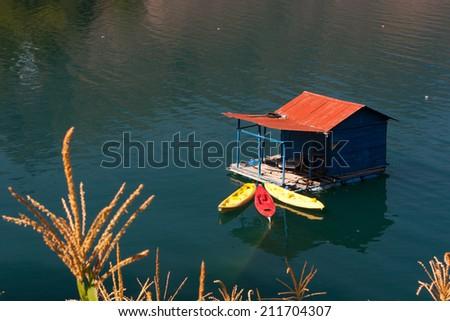 Lake Atitlan and boat dock - stock photo