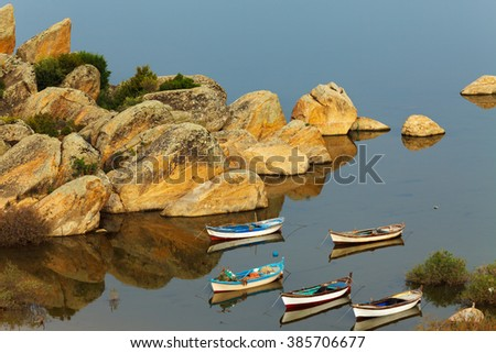 Lake Bafa near Bodrum, Mugla. The lake and the fishing boats in a very tranquil scene. The region is the culture and nature rich national park and  important for tourism and tourists   - stock photo