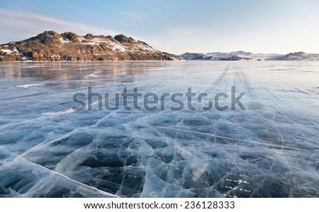 Lake Baikal. Winter morning. Ice road on Olkhon island - stock photo