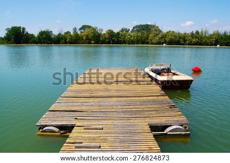 Lake  Boat Dock  with boat and vintage effect - stock photo