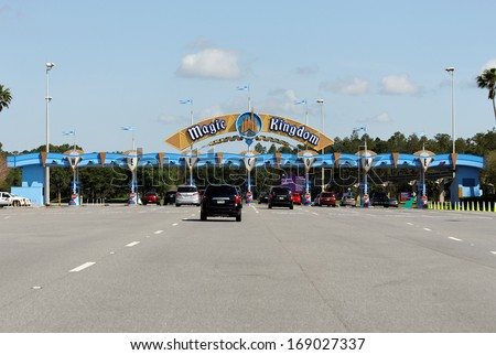 LAKE BUENA VISTA, FL - APRIL 18: Vehicles wait in line to enter the Magic Kingdom section of Walt Disney World on April 18, 2013. Walt Disney World is the worlds most visited theme park. - stock photo