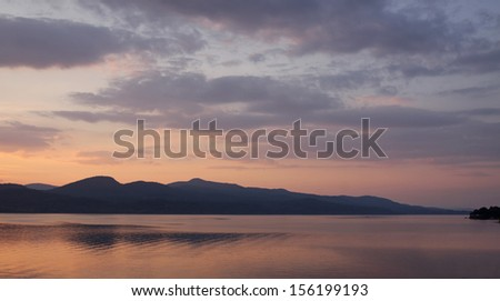 Lake Champlain during a gorgeous sunset.  Shot from the Vermont side near D.A.R. State Park, looking at the New York side.  - stock photo