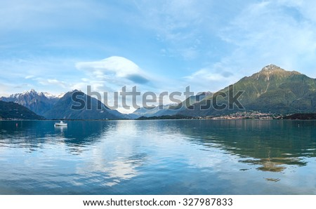 Lake Como (Italy) summer cloudy evening soft color panorama. - stock photo