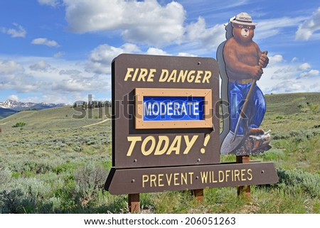 LAKE COUNTY COLORADO-CIRCA JUNE 2014. Smokey Bear reminds visitors about the dangers of forest fires. Fire risk increases with dry conditions and in locations with large areas of Beetle-killed pines. - stock photo