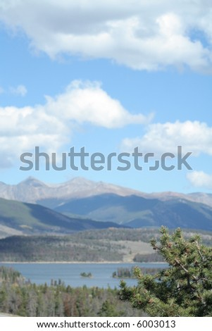 Lake dillon with island and pine trees - stock photo