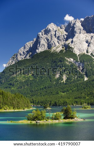 lake Eibsee nearby city Garmisch and alps mountains - stock photo