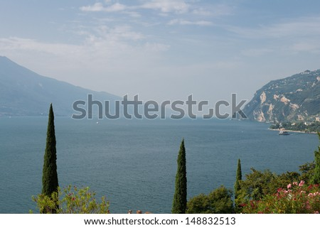 Lake Garda with the alps in the background - stock photo