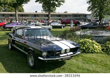 LAKE GEORGE, NY - SEPT 12: A 1967 Ford Mustang Shelby GT500 being shown off at the 21st Annual Adirondack Nationals on September 12, 2009 in Lake George, NY - stock photo
