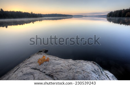 Lake in Autumn Algonquin Muskoka Ontario colors - stock photo