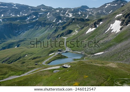 Lake in Grossglockner road. The Grossglockner high alpine road is the highest mountain road in Austria. - stock photo
