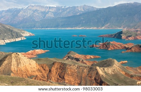Lake in mountains with clouds - stock photo
