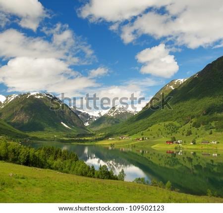 Lake in norwegian mountains - stock photo
